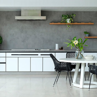 Design ideas for a mid-sized contemporary single-wall kitchen in Perth with flat-panel cabinets, white cabinets, grey splashback, panelled appliances, no island, grey floor and grey benchtop.
