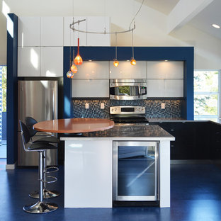 Photo of a mid-sized contemporary l-shaped open plan kitchen in Seattle with an undermount sink, flat-panel cabinets, white cabinets, quartz benchtops, blue splashback, mosaic tile splashback, stainless steel appliances, linoleum floors, with island and blue floor.