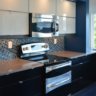 Photo of a mid-sized contemporary l-shaped open plan kitchen in Seattle with an undermount sink, glass-front cabinets, white cabinets, quartz benchtops, blue splashback, glass tile splashback, stainless steel appliances, linoleum floors and with island.