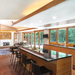 Mid-sized mid-century modern kitchen remodeling - Inspiration for a mid-sized mid-century modern galley kitchen remodel in Detroit