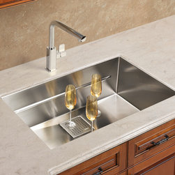 Franke - Franke Peak Series Sink - Then there was the piece on the minimalist trend in architectural products. Franke's new Peak Series continues this trend. Available in seven versions, the sinks are square of form, deep, and minimalist in design. The beauty of this sink line is that the bottom is totally flat and, therefore, useful. A drain cover maintains the overall square geometry, doubles the straining power, and adds a measure of cool by covering the unsightly drain. Accessories such as stainless steel colanders and cutting boards are available.