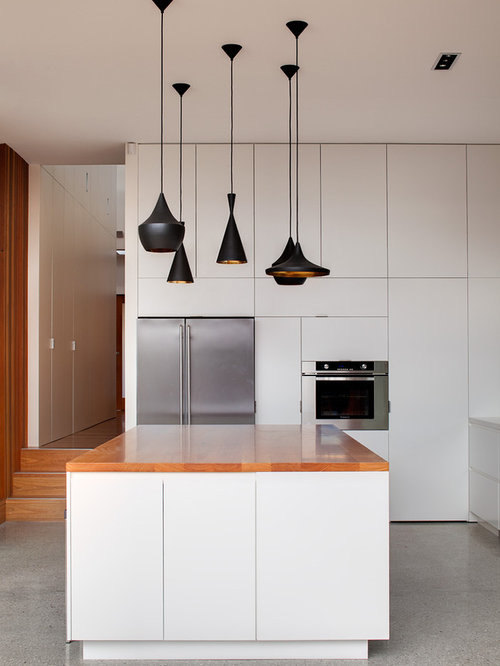 Contemporary kitchen idea in Sydney with flat-panel cabinets, white  cabinets, stainless steel - Battery-powered Pendant Light Houzz
