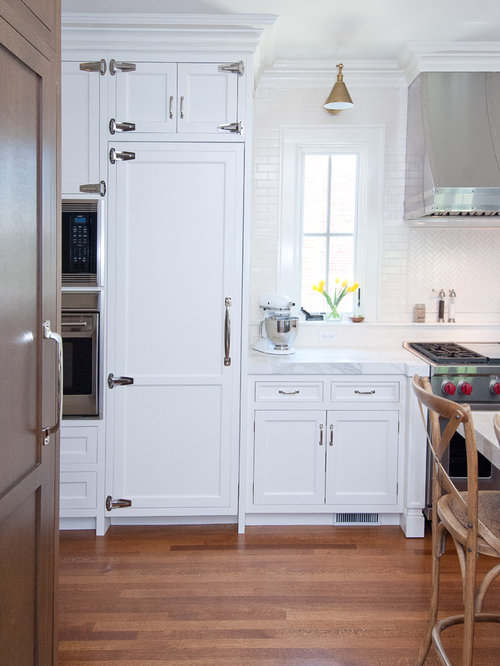Example Of A Clic Kitchen Design In Chicago With Recessed Panel Cabinets White