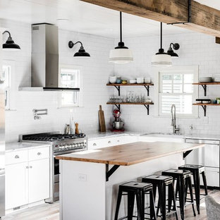 Transitional kitchen designs - Kitchen - transitional l-shaped kitchen idea in Richmond with wood countertops, white backsplash, an island, a farmhouse sink, open cabinets and subway tile backsplash