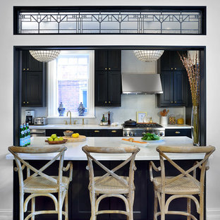 Mid-sized transitional kitchen photos - Mid-sized transitional galley dark wood floor kitchen photo in Toronto with recessed-panel cabinets, black cabinets, quartz countertops, white backsplash and stainless steel appliances