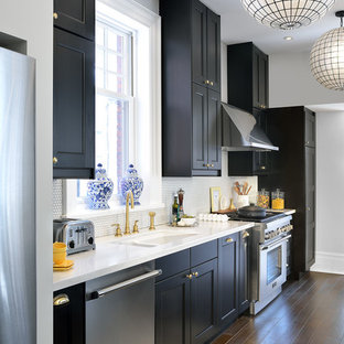 Traditional single-wall separate kitchen in Toronto with black cabinets, quartzite benchtops, white splashback, mosaic tile splashback, stainless steel appliances, a double-bowl sink, shaker cabinets and dark hardwood floors.