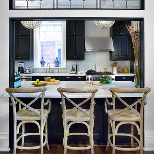 Traditional enclosed kitchen ideas - Enclosed kitchen - traditional galley dark wood floor enclosed kitchen idea in Toronto with shaker cabinets, black cabinets, white backsplash, mosaic tile backsplash, stainless steel appliances and no island