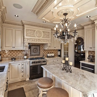 This is an example of a large victorian u-shaped open plan kitchen in Philadelphia with a single-bowl sink, raised-panel cabinets, beige cabinets, marble benchtops, multi-coloured splashback, ceramic splashback, stainless steel appliances, porcelain floors and with island.