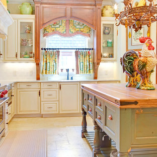 Photo of a traditional kitchen in Orlando with wood benchtops, raised-panel cabinets, distressed cabinets, white splashback, subway tile splashback and stainless steel appliances.