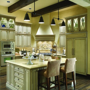 Inspiration for a french country kitchen remodel in Portland with paneled appliances
