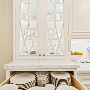 Mid-sized french country open concept kitchen inspiration - Inspiration for a mid-sized french country l-shaped limestone floor, beige floor and wood ceiling open concept kitchen remodel in Other with an undermount sink, beaded inset cabinets, white cabinets, quartzite countertops, white backsplash, marble backsplash, paneled appliances, an island and white countertops
