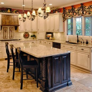 Mid-sized french country eat-in kitchen inspiration - Eat-in kitchen - mid-sized french country l-shaped ceramic tile and beige floor eat-in kitchen idea in Indianapolis with an undermount sink, raised-panel cabinets, beige cabinets, beige backsplash, granite countertops, ceramic backsplash, black appliances and an island