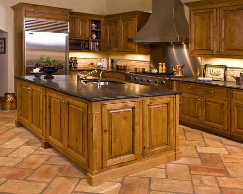 Lovely Rustic Kitchen Idea In Chicago With Stainless Steel Appliances And  Soapstone Countertops
