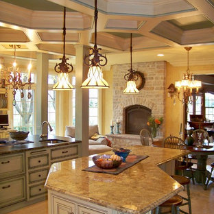 Photo of an expansive eclectic eat-in kitchen in Chicago with raised-panel cabinets, yellow cabinets, granite benchtops, porcelain splashback, coloured appliances, travertine floors and multiple islands.