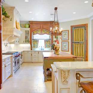 Example of a french country kitchen design in Orlando with paneled appliances