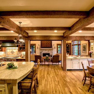 French country eat-in kitchen inspiration - Inspiration for a french country eat-in kitchen remodel in Cleveland with recessed-panel cabinets