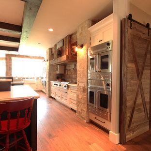French Door Double Ovens Flank Reclaimed Wood Hood Over Two Grills