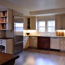 Farmhouse Kitchen by Odenwald Construction Company