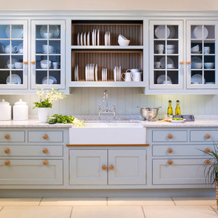 Design ideas for a rural kitchen in Oxfordshire with a belfast sink, recessed-panel cabinets, blue cabinets and blue splashback.