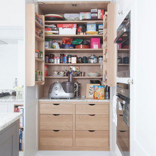 Inspiration for a small classic kitchen pantry in Cardiff with a submerged sink, shaker cabinets, grey cabinets, grey splashback, stainless steel appliances, ceramic flooring and an island.