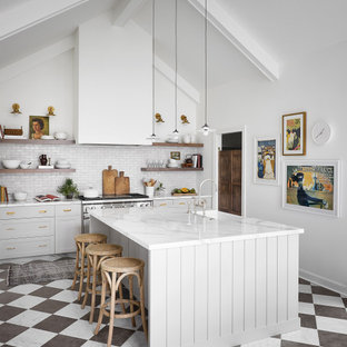 This is an example of a large transitional u-shaped eat-in kitchen in Chicago with a farmhouse sink, shaker cabinets, grey cabinets, white splashback, terra-cotta splashback, stainless steel appliances, marble floors, with island, multi-coloured floor and white benchtop.