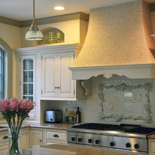 Example of a french country kitchen design in New York with stainless steel appliances, an undermount sink, beaded inset cabinets, beige cabinets, multicolored backsplash, ceramic backsplash and granite countertops