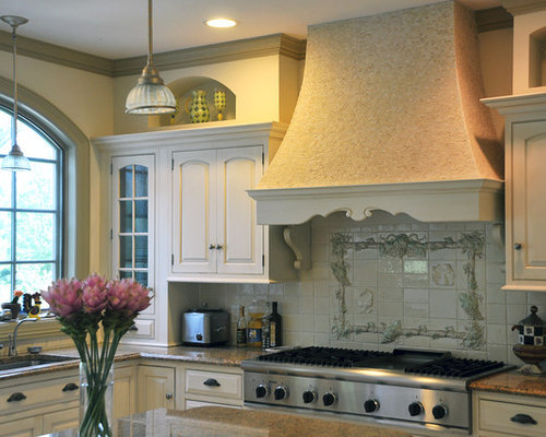 example of a tuscan kitchen design in new york with stainless steel appliances an undermount - French Kitchen Designs