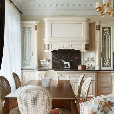 Open concept kitchen - mid-sized traditional single-wall open concept kitchen idea in Saint Petersburg with glass-front cabinets, beige cabinets and an island