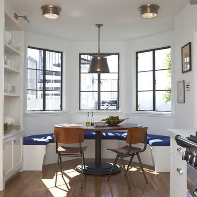 Eat-in kitchen - transitional eat-in kitchen idea in Los Angeles with white cabinets and stainless steel appliances