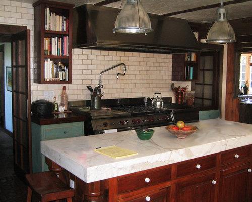kitchen with cement tile backsplash and terra cotta floors