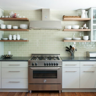 Inspiration for a contemporary kitchen remodel in Austin with open cabinets, white cabinets, concrete countertops, green backsplash, glass tile backsplash and stainless steel appliances