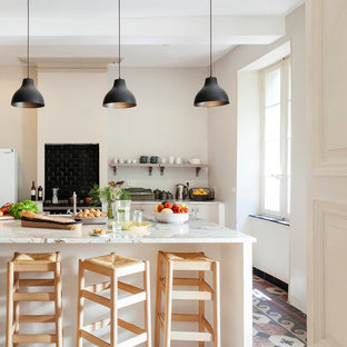 Eat-in kitchen - mid-sized mediterranean galley eat-in kitchen idea in Toulouse with open cabinets, black backsplash, subway tile backsplash, an island and marble countertops