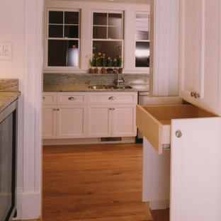 Inspiration for a classic l-shaped kitchen pantry in Boston with a submerged sink, beaded cabinets, white cabinets, granite worktops, stone slab splashback, stainless steel appliances and medium hardwood flooring.