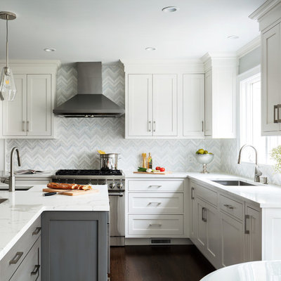 Small transitional u-shaped dark wood floor and brown floor eat-in kitchen photo in New York with an undermount sink, white backsplash, mosaic tile backsplash, stainless steel appliances, an island, white countertops, shaker cabinets and gray cabinets