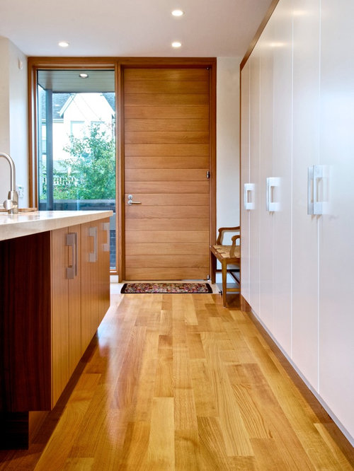 Inspiration for a modern entryway remodel in Toronto with a single ...