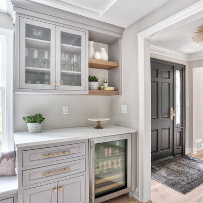 Kitchen - large transitional kitchen idea in New York with an undermount sink, beaded inset cabinets, white cabinets, quartz countertops, white backsplash, mosaic tile backsplash, paneled appliances, an island and white countertops