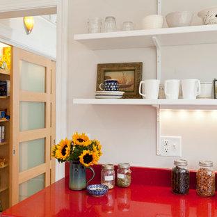 Scandinavian eat-in kitchen photos - Inspiration for a scandinavian porcelain tile eat-in kitchen remodel in Bridgeport with an undermount sink, shaker cabinets, white cabinets, quartz countertops, white backsplash, ceramic backsplash, stainless steel appliances and a peninsula