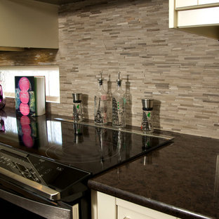 Contemporary open concept kitchen designs - Inspiration for a contemporary dark wood floor open concept kitchen remodel in Calgary with shaker cabinets, white cabinets, granite countertops, gray backsplash, stone tile backsplash and black appliances