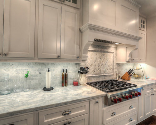 Kitchen design ideas renovations photos with yellow for Kitchen cabinets made from recycled materials