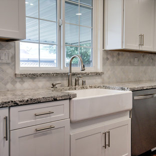 Design ideas for a large transitional galley eat-in kitchen in Orange County with an integrated sink, shaker cabinets, white cabinets, laminate benchtops, white splashback, stone tile splashback, stainless steel appliances, medium hardwood floors and no island.