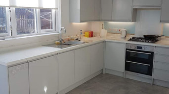 fully fitted kitchen with laminate flooring