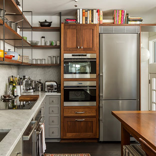 Eclectic eat-in kitchen ideas - Eat-in kitchen - eclectic l-shaped dark wood floor eat-in kitchen idea in Minneapolis with an undermount sink, marble countertops, marble backsplash, stainless steel appliances, white backsplash, white countertops and dark wood cabinets
