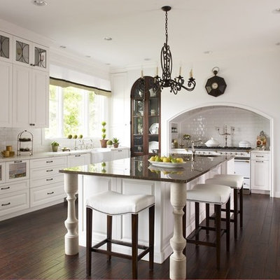 Inspiration for a large timeless kitchen remodel in Detroit with a farmhouse sink, raised-panel cabinets, white cabinets, white backsplash and subway tile backsplash