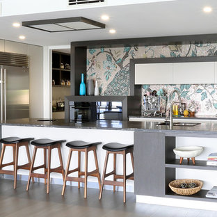 Contemporary u-shaped kitchen in Brisbane with flat-panel cabinets, white cabinets, multi-coloured splashback, mosaic tile splashback, stainless steel appliances, dark hardwood floors and with island.