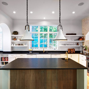 Large mediterranean eat-in kitchen designs - Inspiration for a large mediterranean u-shaped terra-cotta tile eat-in kitchen remodel in Dallas with an undermount sink, shaker cabinets, white cabinets, paneled appliances, an island, granite countertops, white backsplash and terra-cotta backsplash