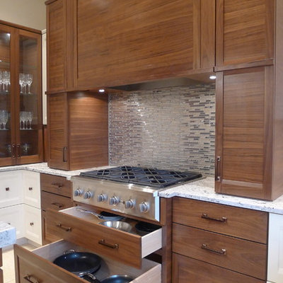 Mid-sized trendy u-shaped ceramic tile kitchen photo in Indianapolis with granite countertops, an undermount sink, recessed-panel cabinets, medium tone wood cabinets, metallic backsplash, metal backsplash and stainless steel appliances