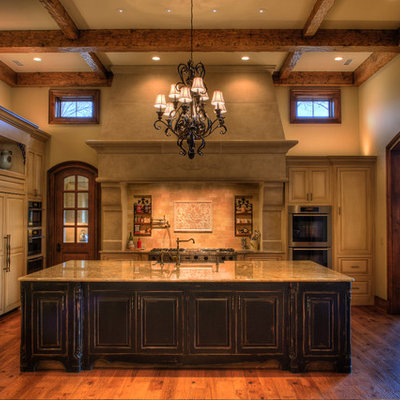 Inspiration for a rustic l-shaped kitchen remodel in Other with an undermount sink, raised-panel cabinets, beige cabinets, beige backsplash and paneled appliances
