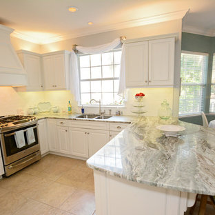 Mid-sized traditional eat-in kitchen photos - Inspiration for a mid-sized timeless u-shaped ceramic floor eat-in kitchen remodel in Jacksonville with an undermount sink, raised-panel cabinets, white cabinets, granite countertops, white backsplash, ceramic backsplash, stainless steel appliances and a peninsula