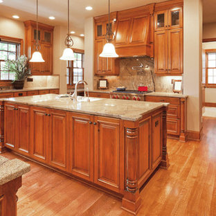 Large craftsman eat-in kitchen appliance - Inspiration for a large craftsman l-shaped medium tone wood floor and brown floor eat-in kitchen remodel in San Francisco with raised-panel cabinets, medium tone wood cabinets, granite countertops, gray backsplash, ceramic backsplash, stainless steel appliances, an island and an undermount sink