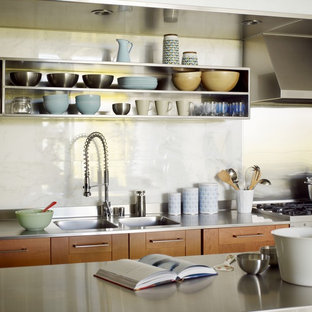 Industrial kitchen photos - Kitchen - industrial single-wall kitchen idea in Los Angeles with stainless steel countertops, an integrated sink, open cabinets, white backsplash, stone tile backsplash, stainless steel cabinets and stainless steel appliances